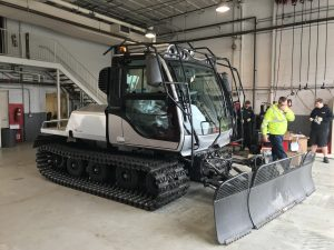 image of the Husky snow plow in garage