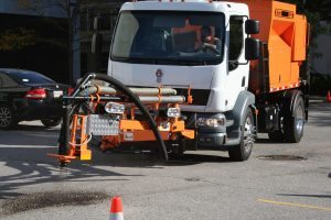 image of the Bergkamp SP5 Spray Patcher fixing a pot hole